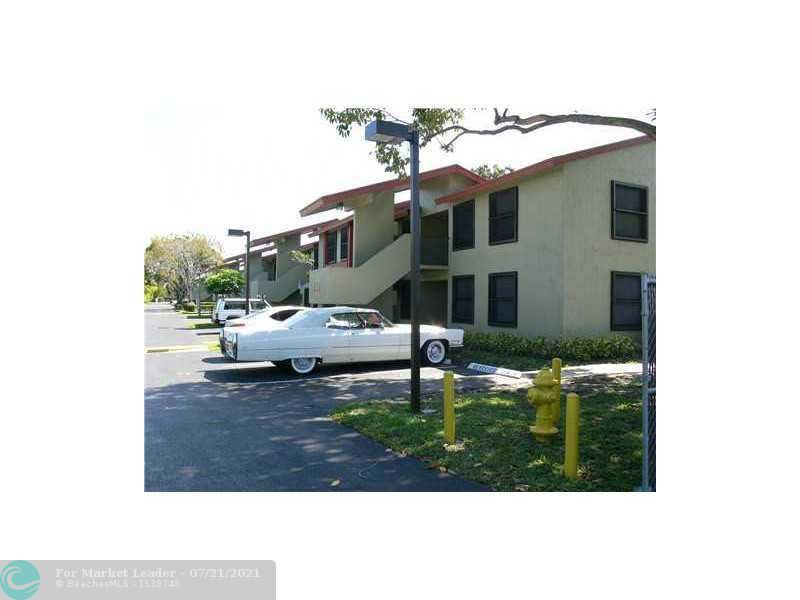 Photo of 218 Lake Pointe Dr #207, Oakland Park, FL 33309 (MLS # F10293548)