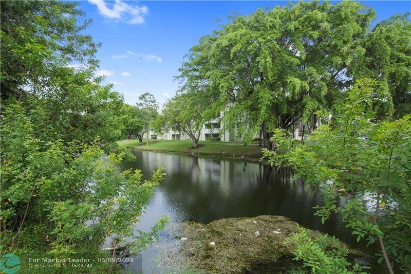 Photo of 201 SW 87th Ter, Plantation, FL 33324 (MLS # F10283554)