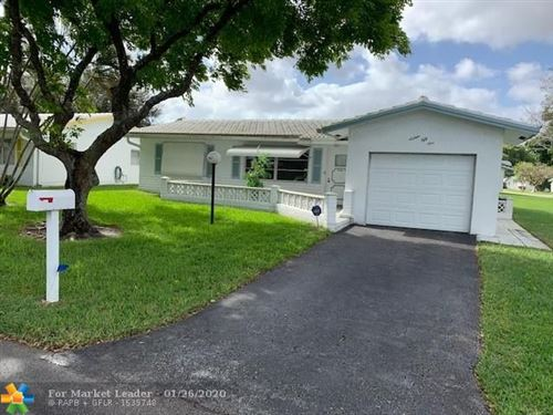 Photo of 1651 NW 82nd Ter, Plantation, FL 33322 (MLS # F10212560)