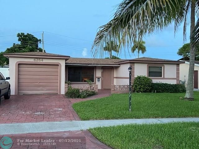 Photo of 4284 NW 37th Ter, Lauderdale Lakes, FL 33309 (MLS # F10292561)