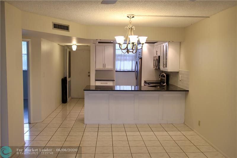 Photo of 5300 NE 24th Ter #202, Fort Lauderdale, FL 33308 (MLS # F10232564)