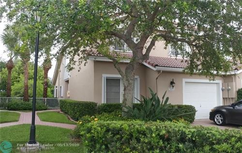 Photo of 7406 NW 61st Ter, Parkland, FL 33067 (MLS # F10207566)