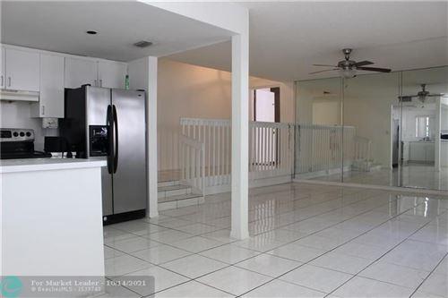 Photo of 4705 SW 62nd Ave #101, Davie, FL 33314 (MLS # F10304566)