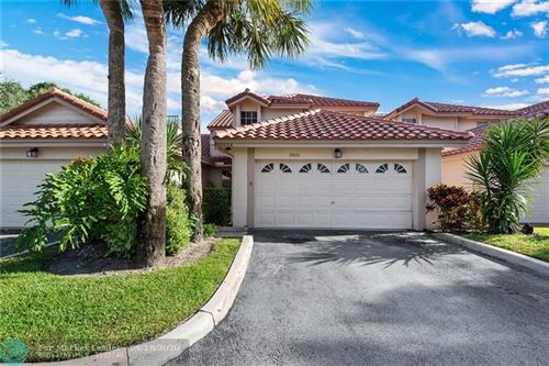 Photo of 10826 Cypress Glen Dr #10826, Coral Springs, FL 33071 (MLS # F10249569)