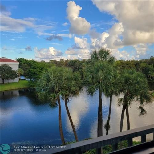Photo of 3050 NW 42nd Ave #C-403, Coconut Creek, FL 33066 (MLS # F10304569)