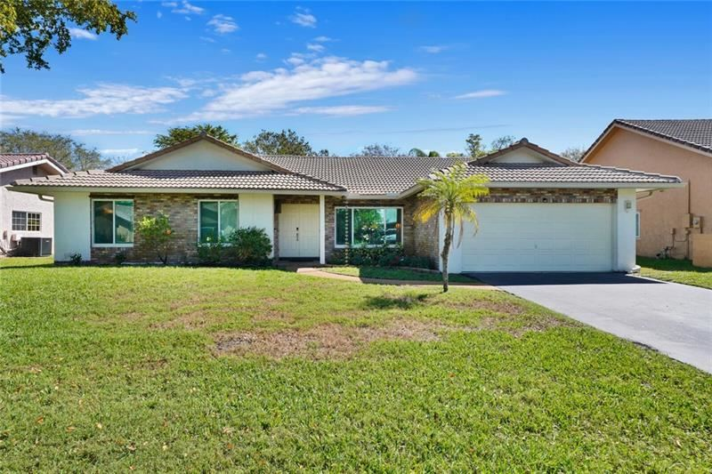 Photo of 687 NW 107th Ln, Coral Springs, FL 33071 (MLS # F10272569)