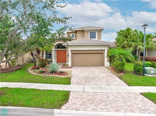 Photo of 7822 NW 124th Ter, Parkland, FL 33076 (MLS # F10290571)