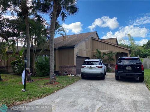 Photo of 6627 Stratford Dr, Parkland, FL 33067 (MLS # F10254572)