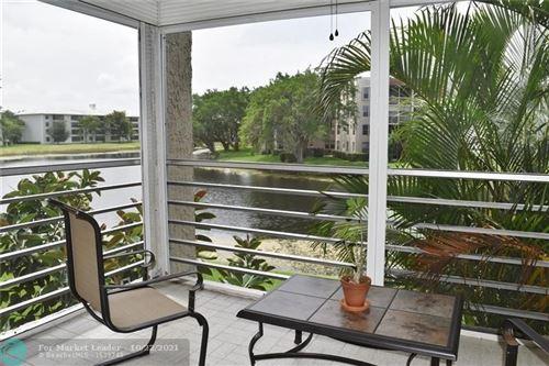 Photo of 9230 Lagoon Pl #215, Davie, FL 33324 (MLS # F10301577)