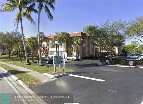 Photo of 3060 Holiday Springs Blvd #207, Margate, FL 33063 (MLS # F10304577)
