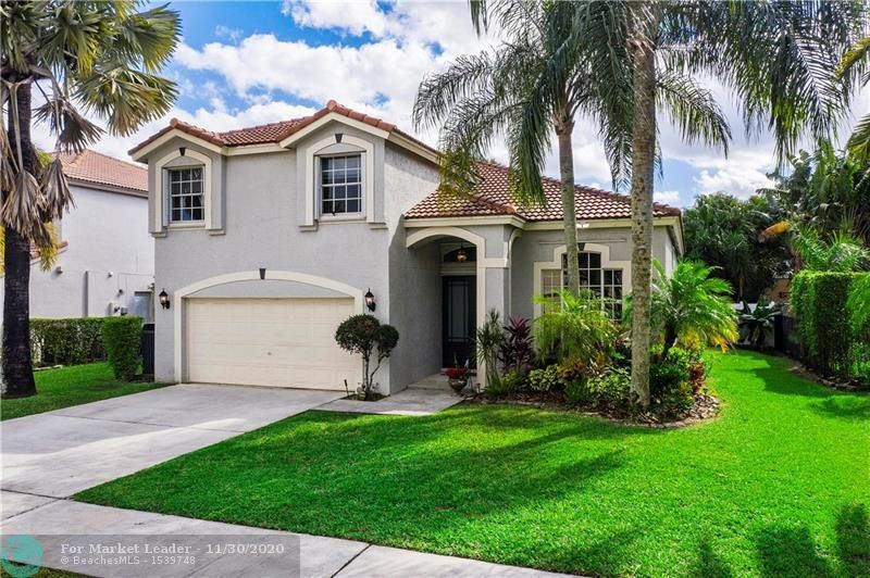 Photo of 5810 NW 62nd St, Parkland, FL 33067 (MLS # F10260579)