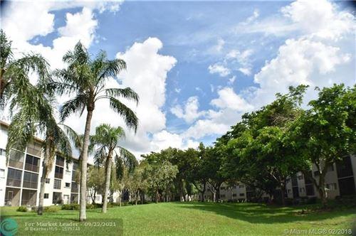 Photo of 1200 SW 130th Ave #G106, Pembroke Pines, FL 33027 (MLS # F10301582)