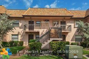 Photo of 10629 NW 10th St #203, Pembroke Pines, FL 33026 (MLS # F10176587)