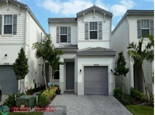 Photo of 4504 NW 48th Ter, Tamarac, FL 33319 (MLS # F10280587)