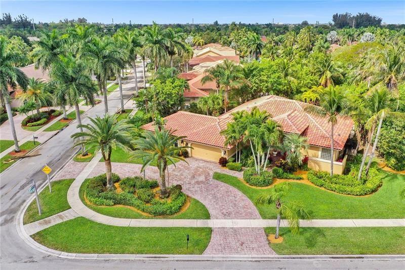 Photo of 501 NW 108th Ave, Plantation, FL 33324 (MLS # F10272594)