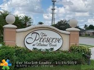 Photo of 2140 NW 78th Ave #104, Pembroke Pines, FL 33024 (MLS # F10202596)