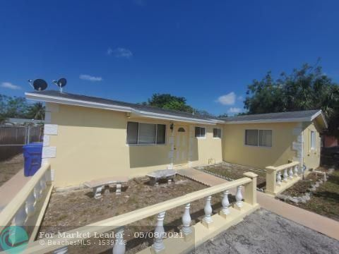 Photo of 513 SW 71st Ave, North Lauderdale, FL 33068 (MLS # F10283597)