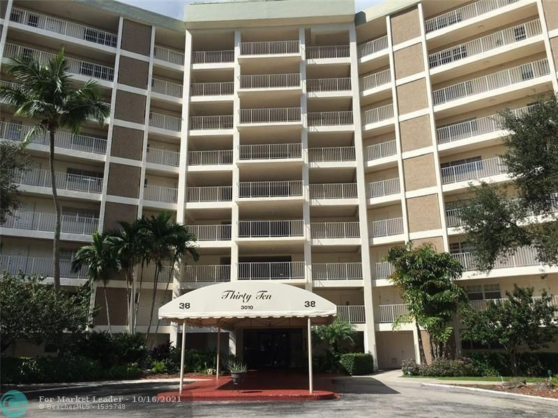 Photo of 3010 N Course Dr #103, Pompano Beach, FL 33069 (MLS # F10304597)