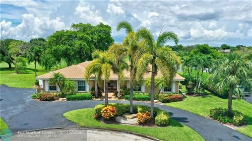 Photo of 11015 NW 28th St, Coral Springs, FL 33065 (MLS # F10242601)