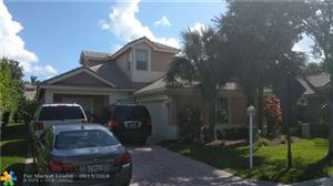 Photo of 10906 NW 62nd Ct, Parkland, FL 33076 (MLS # F10136604)