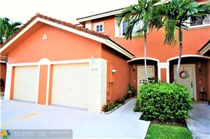 Photo of 1164 NW 100th Ave #1164, Pembroke Pines, FL 33024 (MLS # F10181606)
