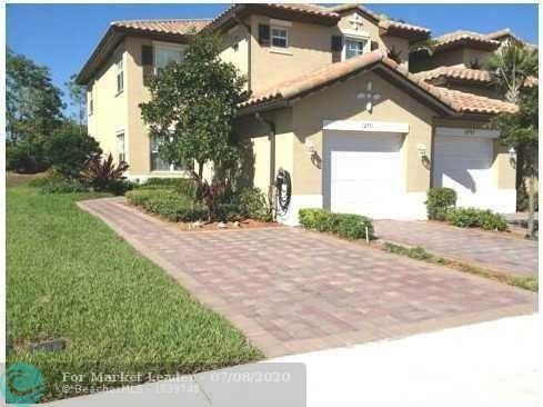 Photo of 12771 NW 83rd Ct, Parkland, FL 33076 (MLS # F10237609)