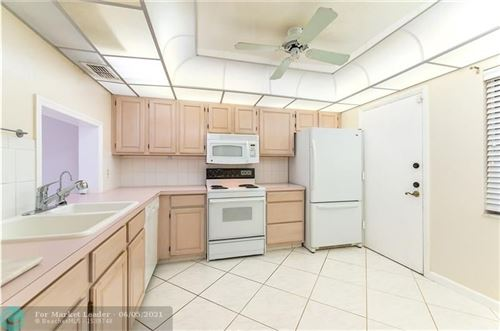 Photo of 640 Tennis Club Dr #301, Fort Lauderdale, FL 33311 (MLS # F10284611)