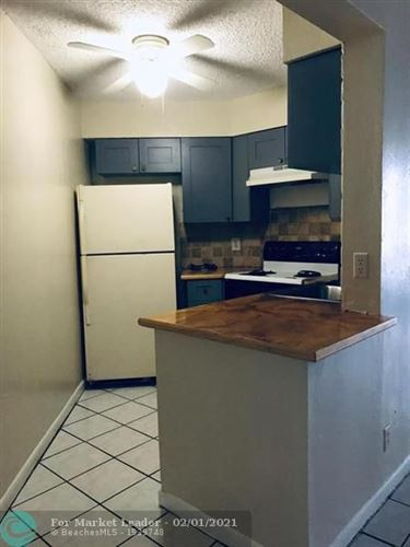 Photo of 214 Lake Pointe Dr #107, Oakland Park, FL 33309 (MLS # F10268615)