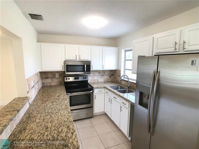 Photo of 1313 NW 58th Ter, Margate, FL 33063 (MLS # F10259616)