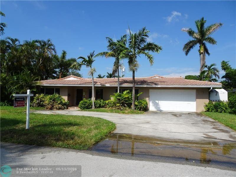 Photo of 2457 NE 27th Ter, Fort Lauderdale, FL 33305 (MLS # F10284618)