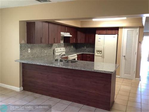 Photo of 5220 NW 17th Ct, Lauderhill, FL 33313 (MLS # F10268620)