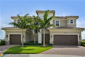 Photo of 8750 Lakeview Dr, Parkland, FL 33076 (MLS # F10158626)