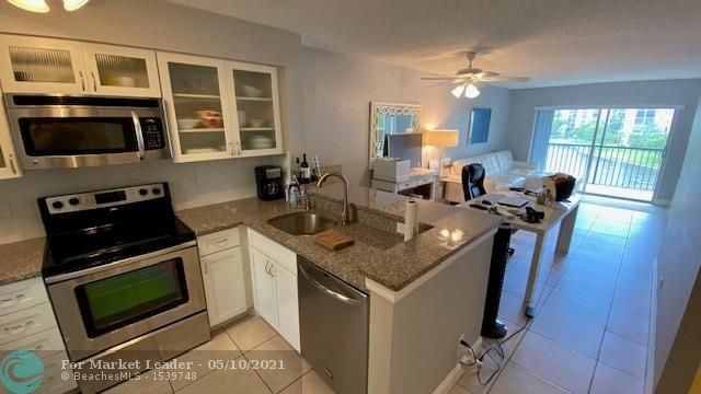 Photo of 2228 N Cypress Bend Dr #409, Pompano Beach, FL 33069 (MLS # F10283626)