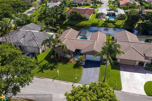 Photo of 6426 NW 53rd St, Coral Springs, FL 33067 (MLS # F10203631)