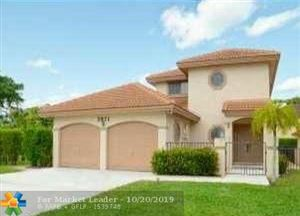 Photo of 3971 NW 5th Dr, Deerfield Beach, FL 33442 (MLS # F10199637)