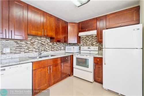 Photo of 9481 Evergreen Pl #404, Davie, FL 33324 (MLS # F10304640)