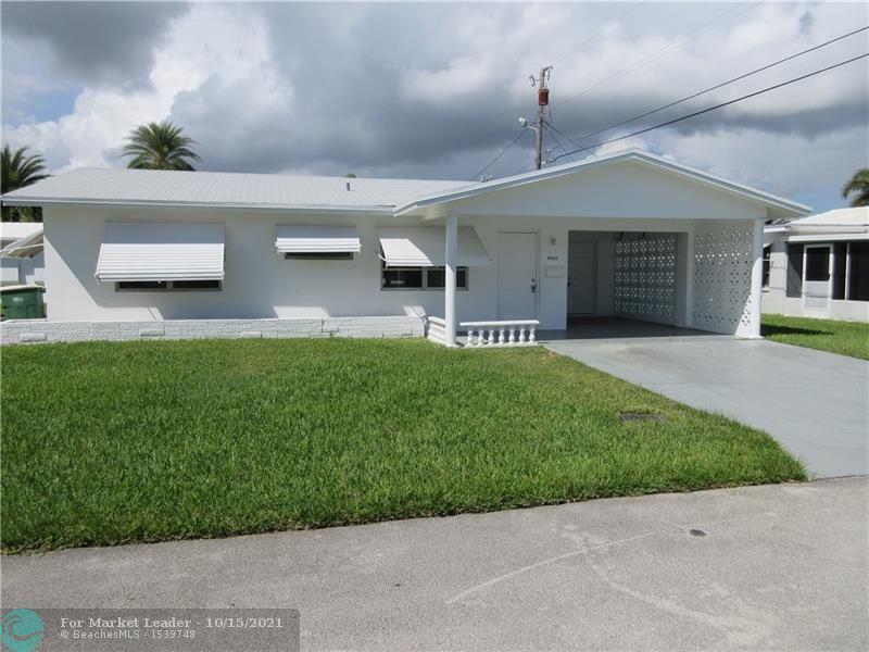 Photo of 5405 NW 27th Way, Tamarac, FL 33309 (MLS # F10304641)