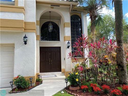 Photo of 5721 NW 63rd Pl, Parkland, FL 33067 (MLS # F10292643)
