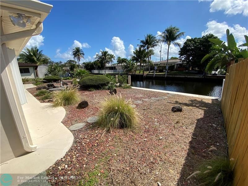 Photo of 1720 NE 63rd Ct, Fort Lauderdale, FL 33334 (MLS # F10217647)