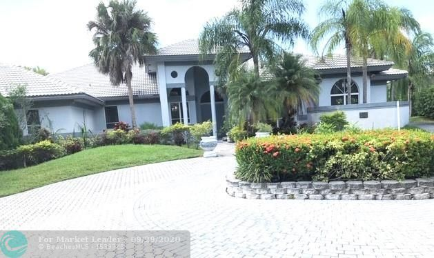 Photo of 16390 Paddock Ln, Weston, FL 33326 (MLS # F10249648)