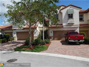 Photo of 6097 NW 116th Dr, Coral Springs, FL 33076 (MLS # F10167653)