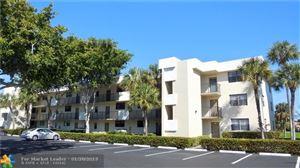 Photo of 2420 Deer Creek Country Club Blvd #104, Deerfield Beach, FL 33442 (MLS # F10158655)