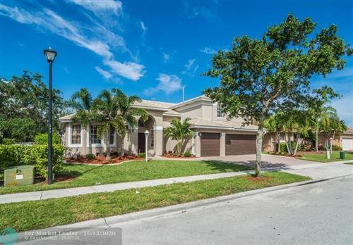 Photo of 1828 NW 140th Ter, Pembroke Pines, FL 33028 (MLS # F10253656)