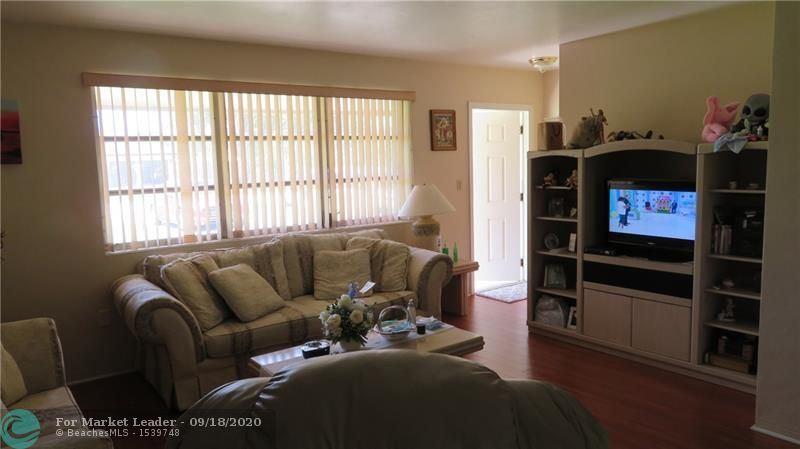 Photo of 8451 Johnson St, Pembroke Pines, FL 33024 (MLS # F10249657)