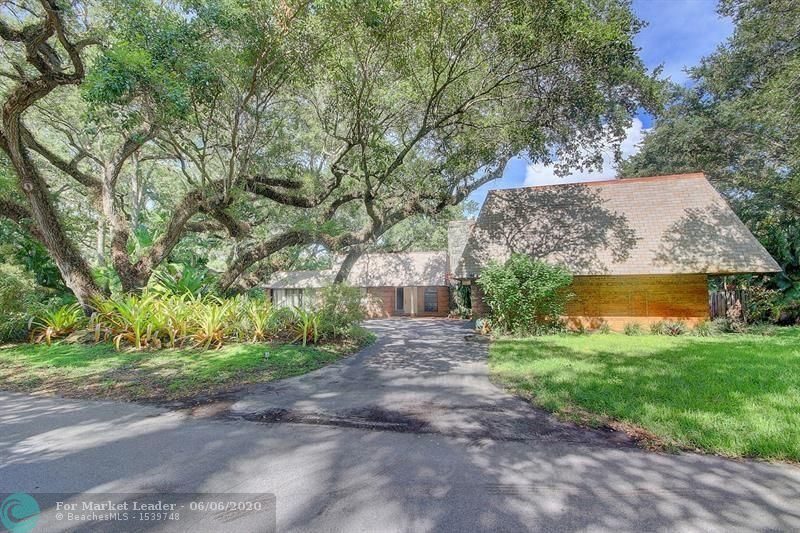 Photo of 5940 SW 37th Ave, Fort Lauderdale, FL 33312 (MLS # F10232664)