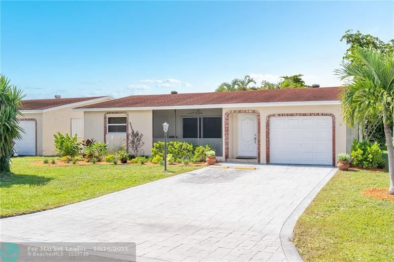 Photo of 4921 NW 13th Ave, Deerfield Beach, FL 33064 (MLS # F10303665)