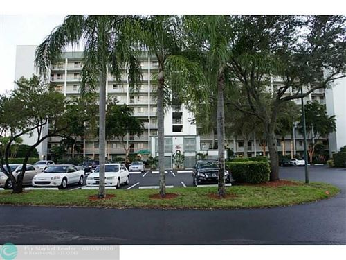 Photo of 2240 N CYPRESS BEND DR #306, Pompano Beach, FL 33069 (MLS # F10207668)