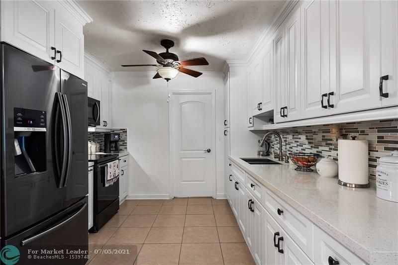 Photo of 2360 NW 63rd Ave, Sunrise, FL 33313 (MLS # F10291669)