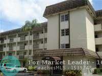 Photo of 6020 NW 44th St #401, Lauderhill, FL 33319 (MLS # F10301670)