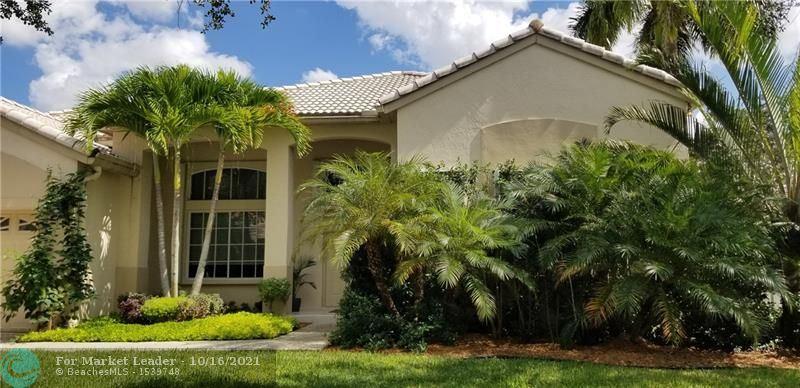 Photo of 849 Heritage Dr, Weston, FL 33326 (MLS # F10304672)